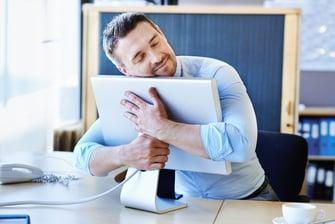 jit manufacturing roll forming manufacturer - man hugging computer