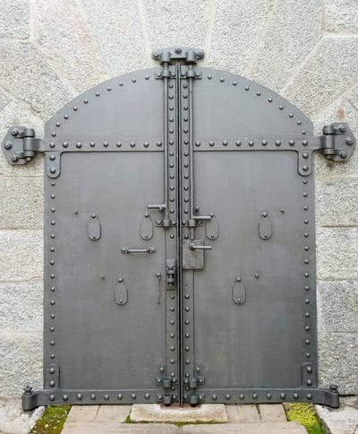 steel door inset on concrete wall