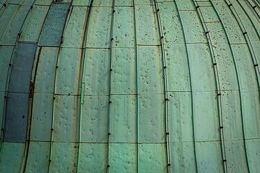 what metals turn green - copper patina effect on roof